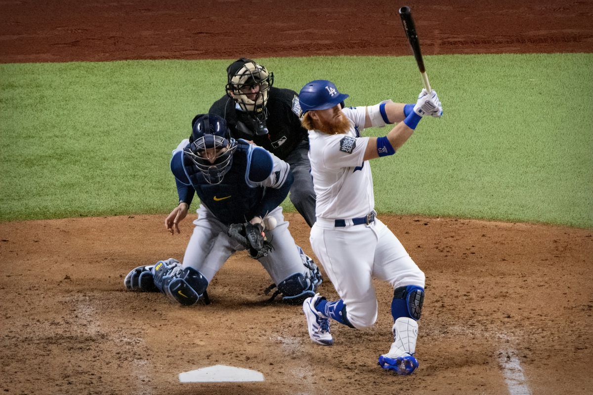 Los Angeles Dodgers third baseman Justin Turner (10) strikes out against Tampa Bay Rays starting pitcher Blake Snell (not pictured) during the fourth inning in game six of the 2020 World Series at Globe Life Field.