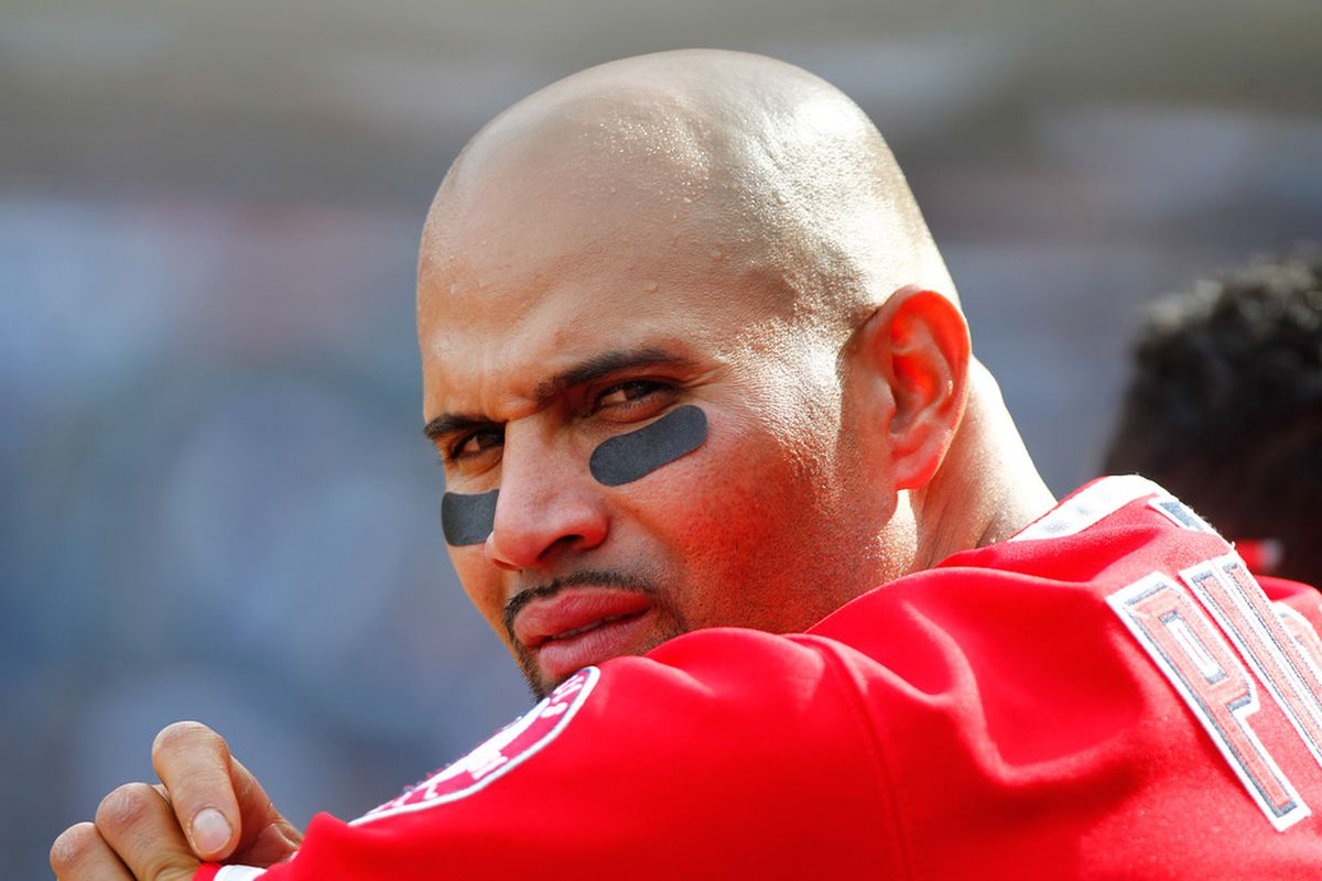 Apr. 14, 2012; Bronx, NY, USA; Los Angeles Angels first baseman Albert Pujols (5) looks out from the dugout during the ninth inning against the New York Yankees at Yankee Stadium. Angels won 7-1. Mandatory Credit: Debby Wong-US PRESSWIRE