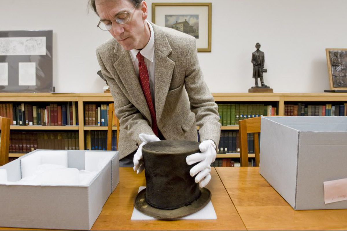 James M. Cornelius shows the Abraham Lincoln hat in 2012.