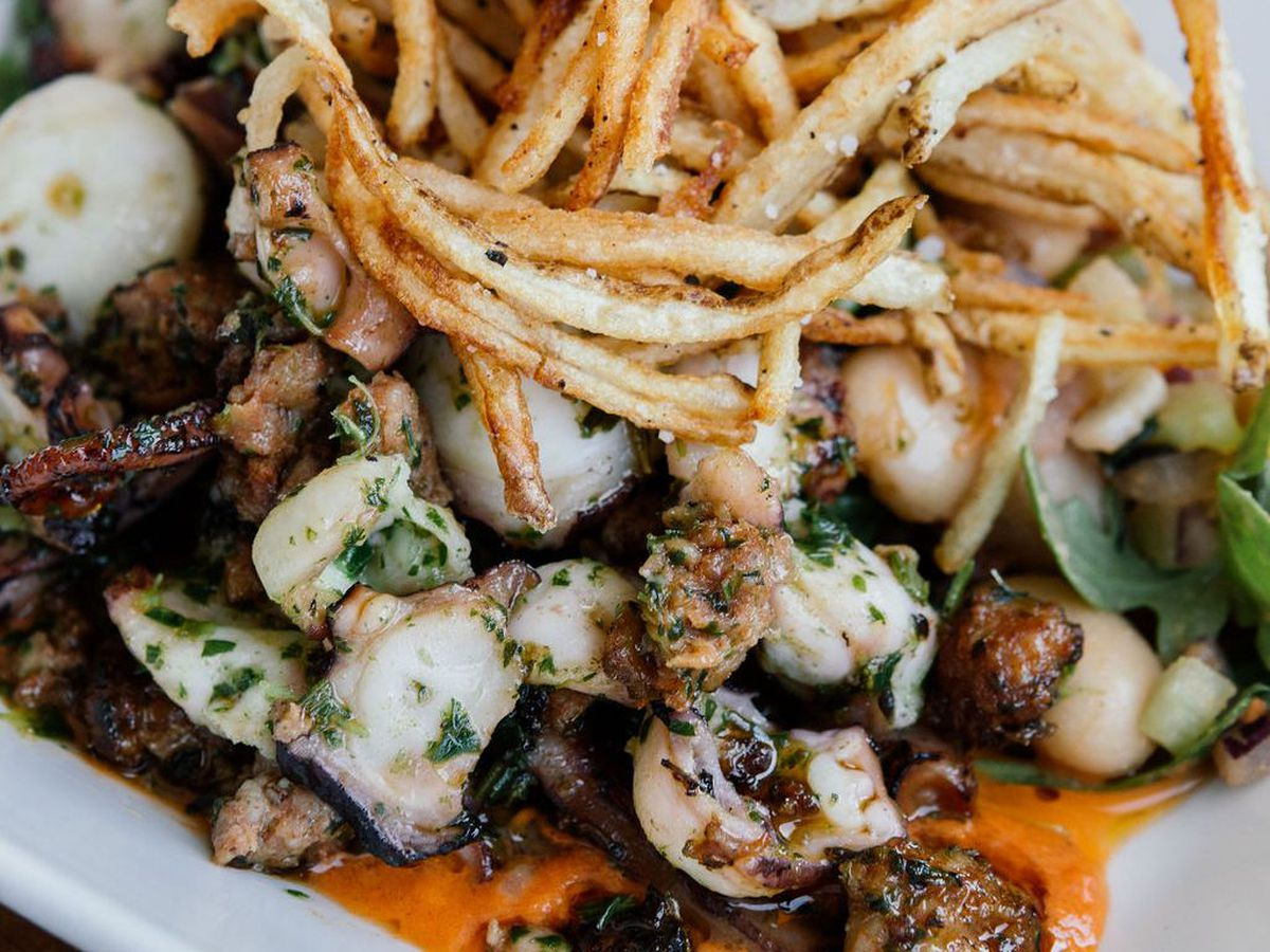 Plate of seafood with potato strings on top