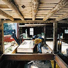 <p>On the first floor of the barn, Tom used 12-inch-thick SIP floor panels for their added strength.</p>