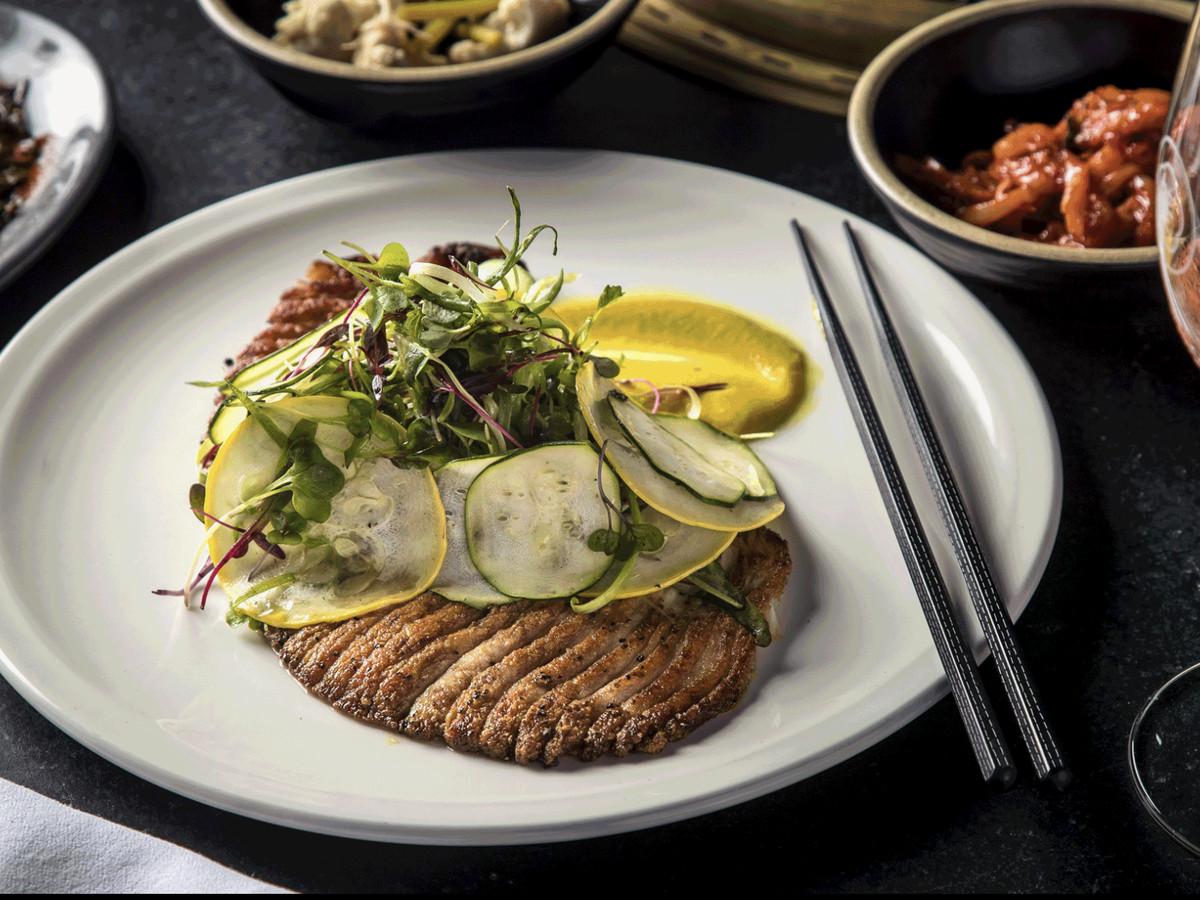 Steak and vegetables on fancy dinner plate