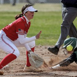 Clearfiled's Miranda Mansfield slides into second base ahead of the tag from Bountiful shortstop Shiloh Johnson during a game at Millcreek Junior High School in Bountiful on Wednesday, March 24, 2021.