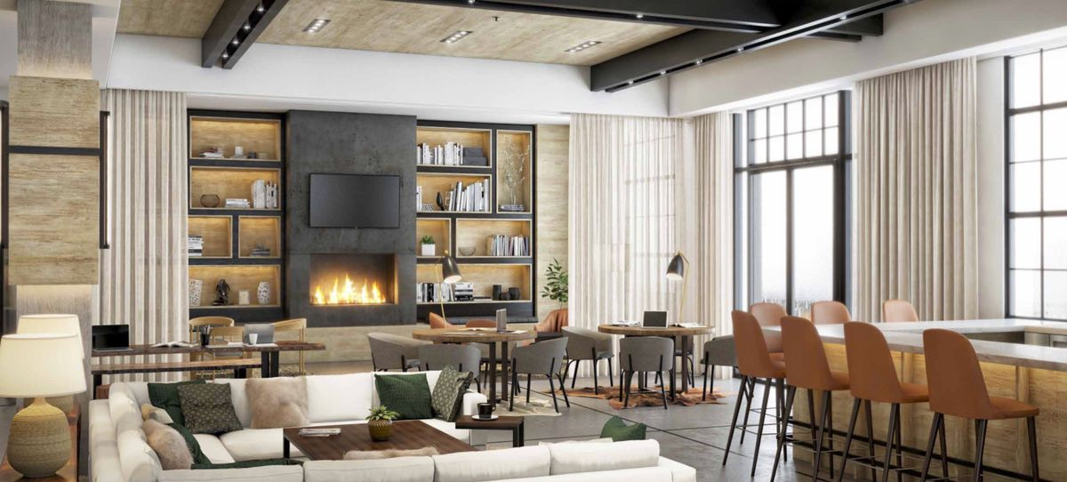 A rendering of Draw Bar at the Interlock with the corner of a white marble bar with 7 leather back bar seats, a white u-shaped couch, 4-top tables in the background next to a fire place with a fire