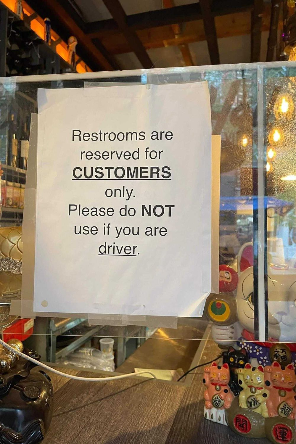 A sign seen on a Lower East Side restaurant's window on April 19, 2021 in Manhattan, NY prohibits delivery drivers from using their restroom facilities.