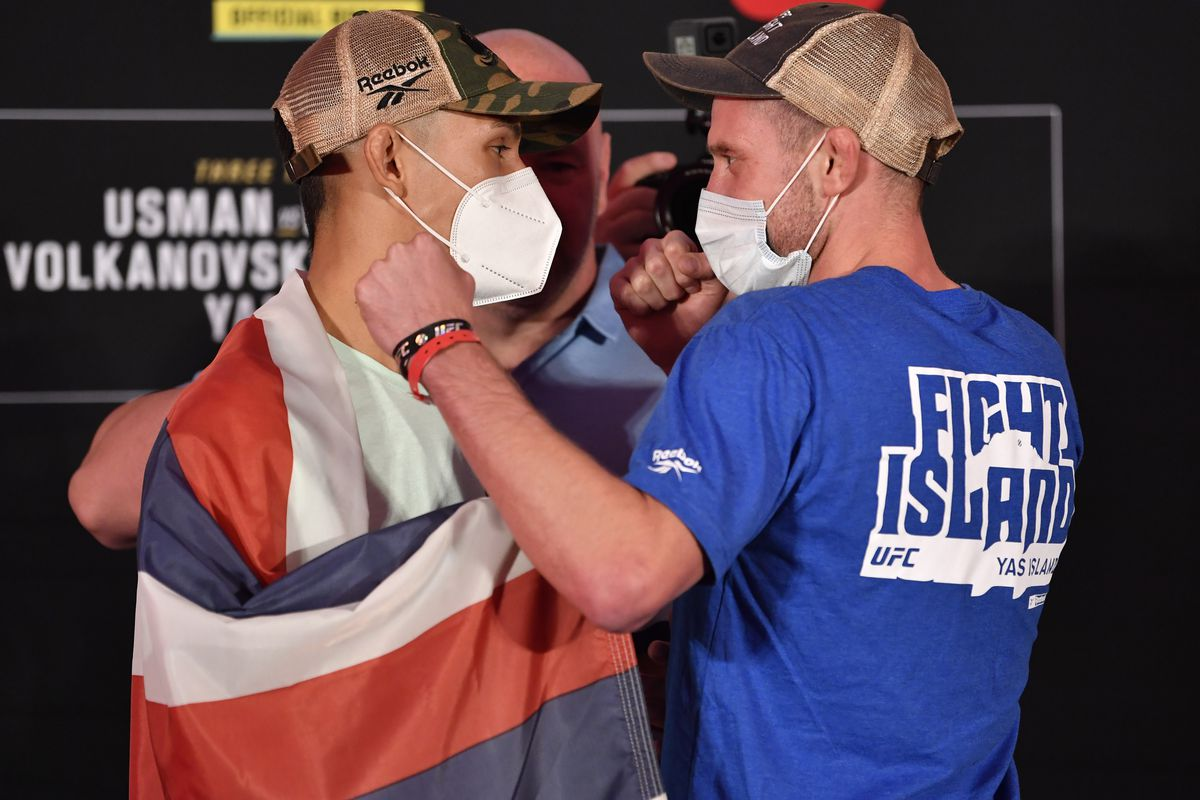 Opponents Martin Day and Davey Grant of England face off during the UFC 251 official weigh-in inside Flash Forum at UFC Fight Island on July 10, 2020 on Yas Island Abu Dhabi, United Arab Emirates.