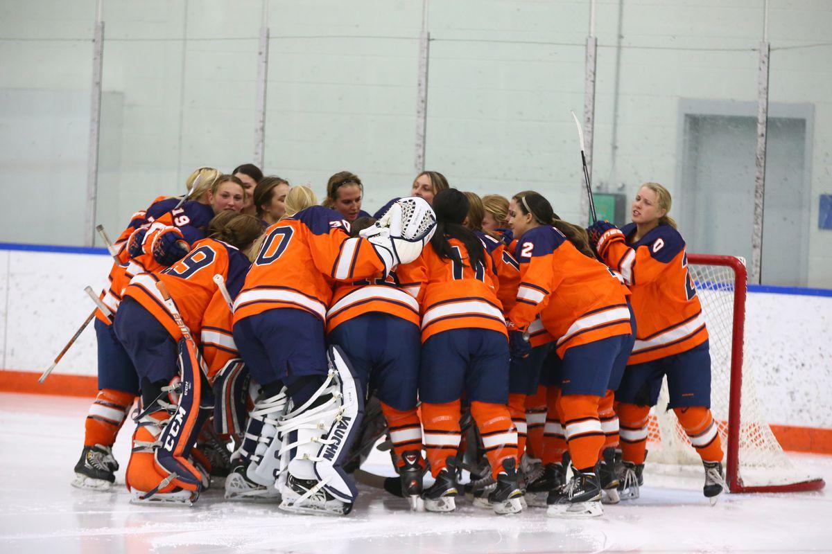 Syracuse women's ice hockey team huddling before a game.