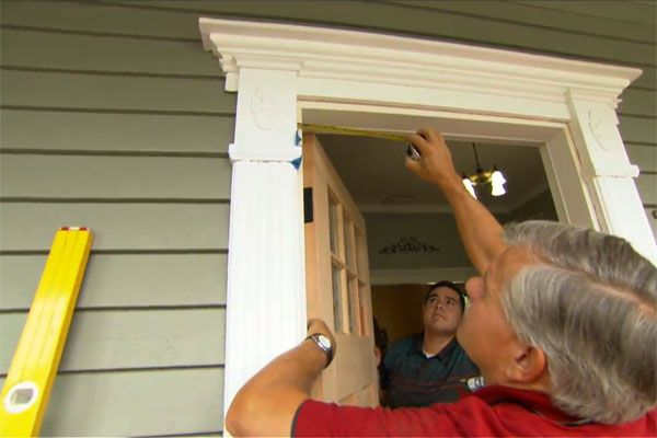 Man Measuring Door Frame