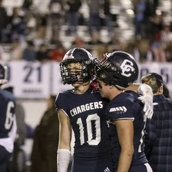 Corner Canyon players console each other after a loss to Lone Peak that ended their 48-game winning streak at Corner Canyon High School in Draper on Thursday, Oct. 7, 2021.