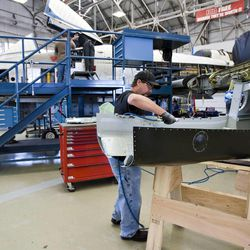 Civilian sheet metal mechanic Bronson Shaw works on parts for the Fairchild Republic A-10 Thunderbolt aircraft at Hill Air Force Base on June 14, 2011.