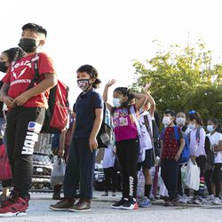 Students wait in line as they return to school on the first day of classes at Alessandro Volta Elementary School.