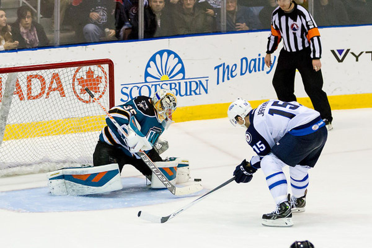 Worcester Sharks goaltender Harri Sateri watches the puck drift away after St. John's IceCaps forward Jason Jaffray failed to get a shot off in the fifth round of the shootout Saturday night at the Mile One Centre.