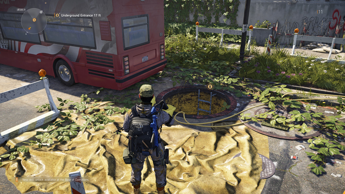 A soldier stands in front of a sewer entrance in The Division 2