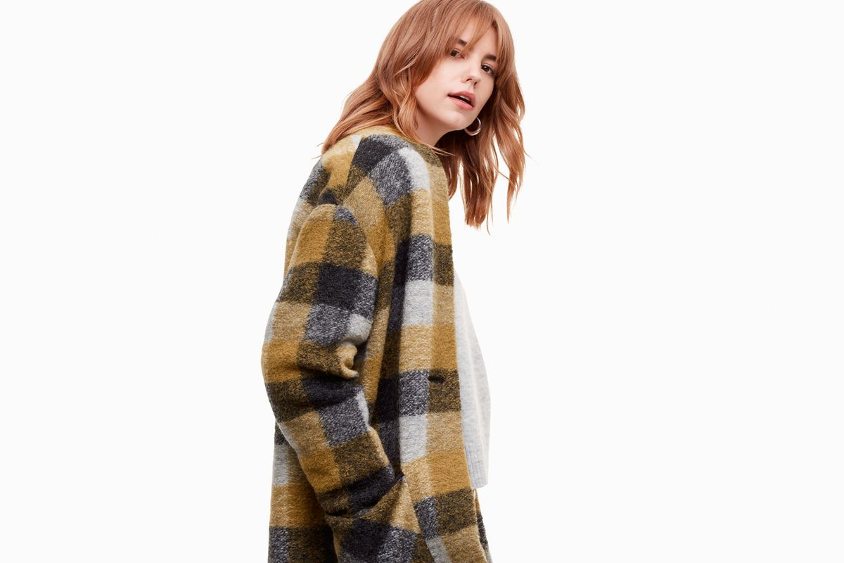 A model in a yellow plaid jacket