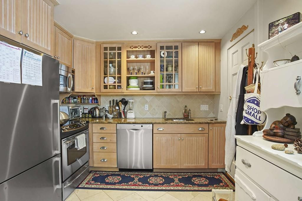 Another kitchen with a counter and cabinetry against the wall.