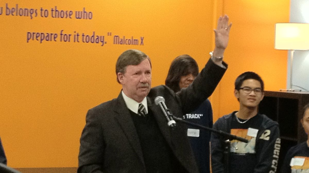 Aurora Superintendent John Barry exults at the opening of the College Track-Summit 54 headquarters Thursday.