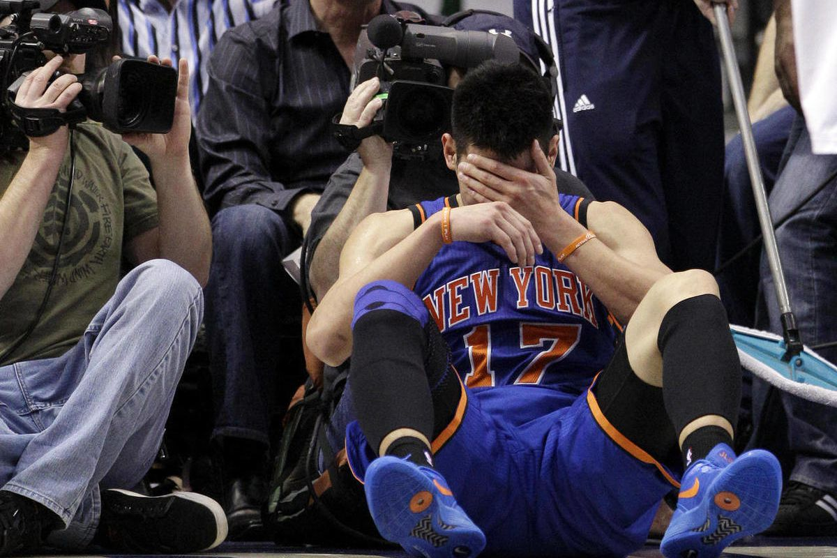 FILE - In this March 6, 2012, file photo, New York Knicks' Jeremy Lin reacts after being fouled during an NBA basketball game against the Dallas Mavericks in Dallas. Lin is having left knee surgery and will miss six weeks, likely ending his amazing breakt