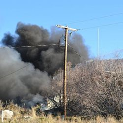 Firefighters work to put out a warehouse blaze at Morgan Valley Polaris in Morgan, Utah, on Saturday, March 22. The warehouse is the Wilkinson Construction shop at about 800 E. 100 South.