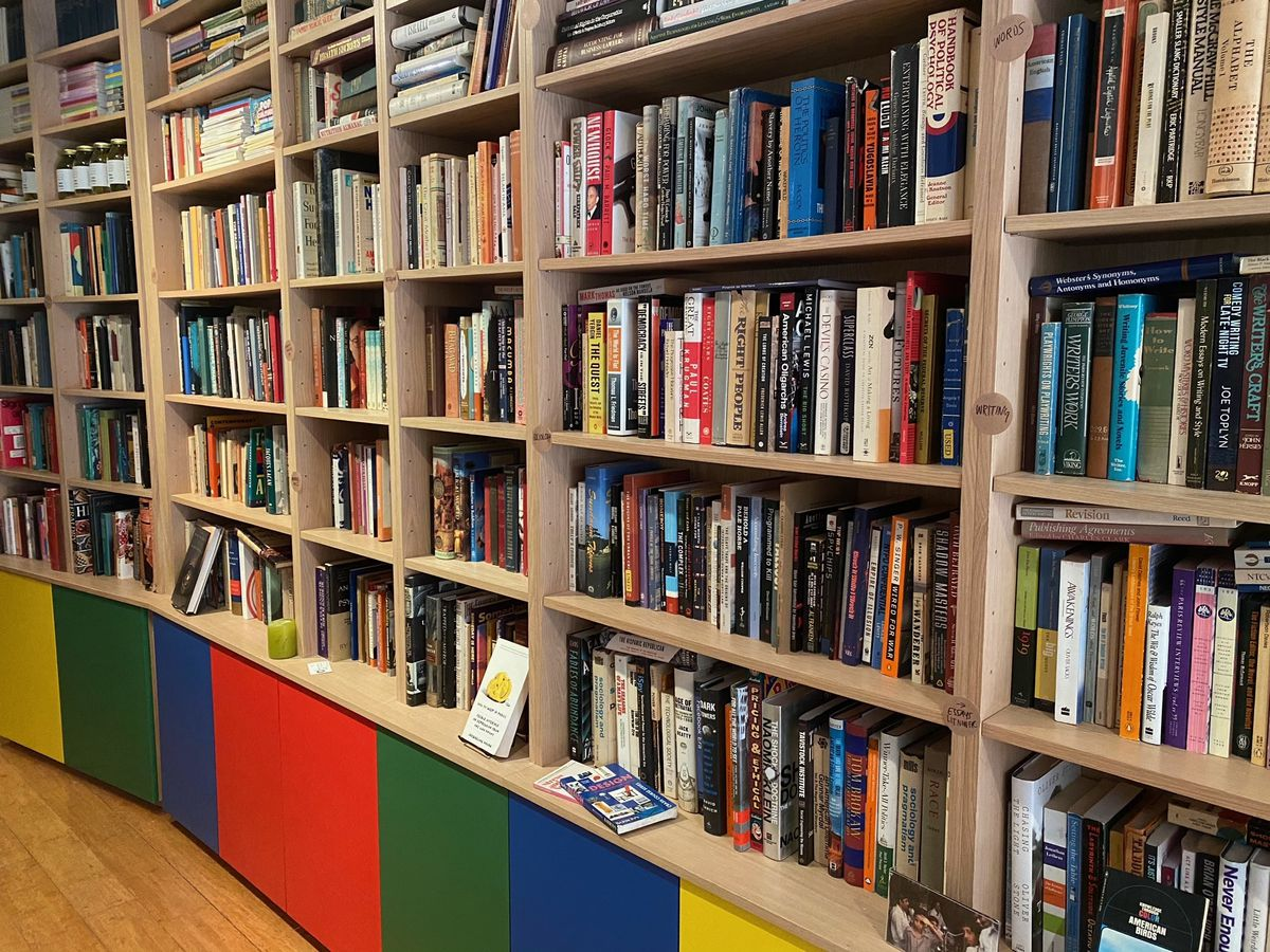 Bookshelves lined with books on a hardwood floor