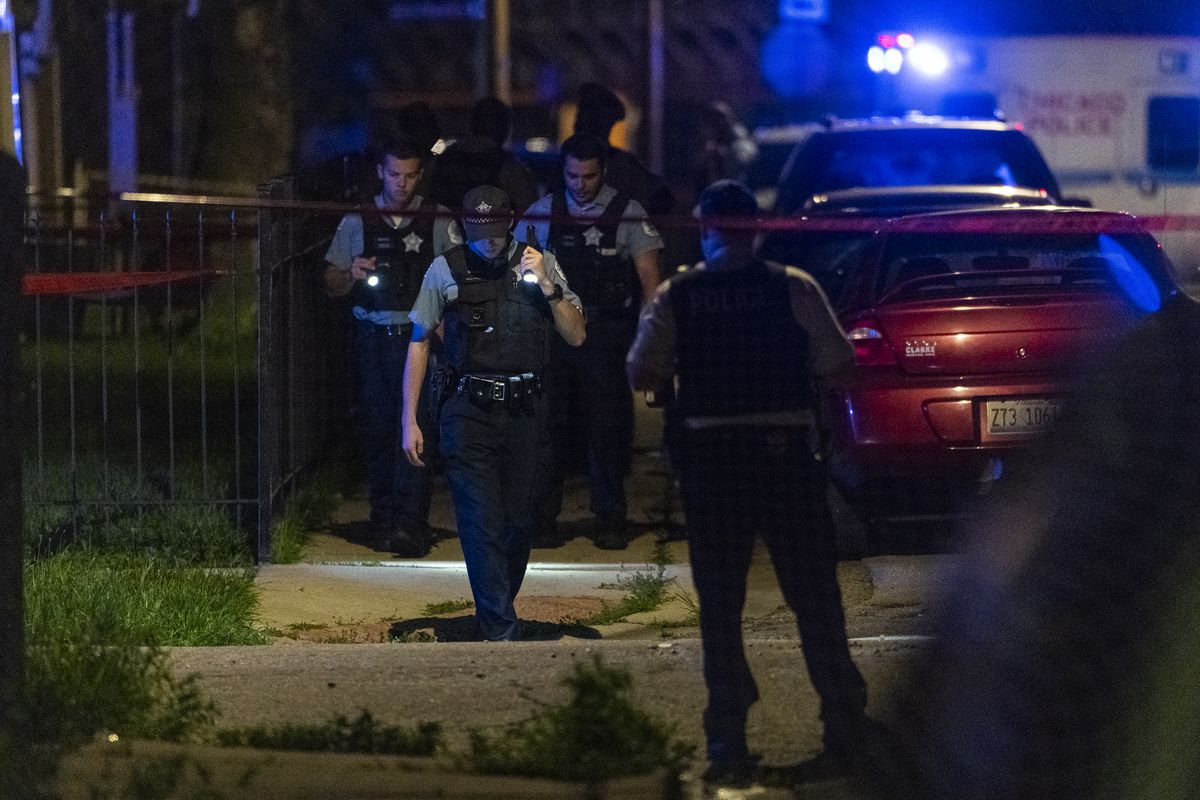 Chicago police work the scene where 4 people were shot in the 8900 block of South Carpenter Street, in the Gresham neighborhood, Saturday, July 3, 2021.