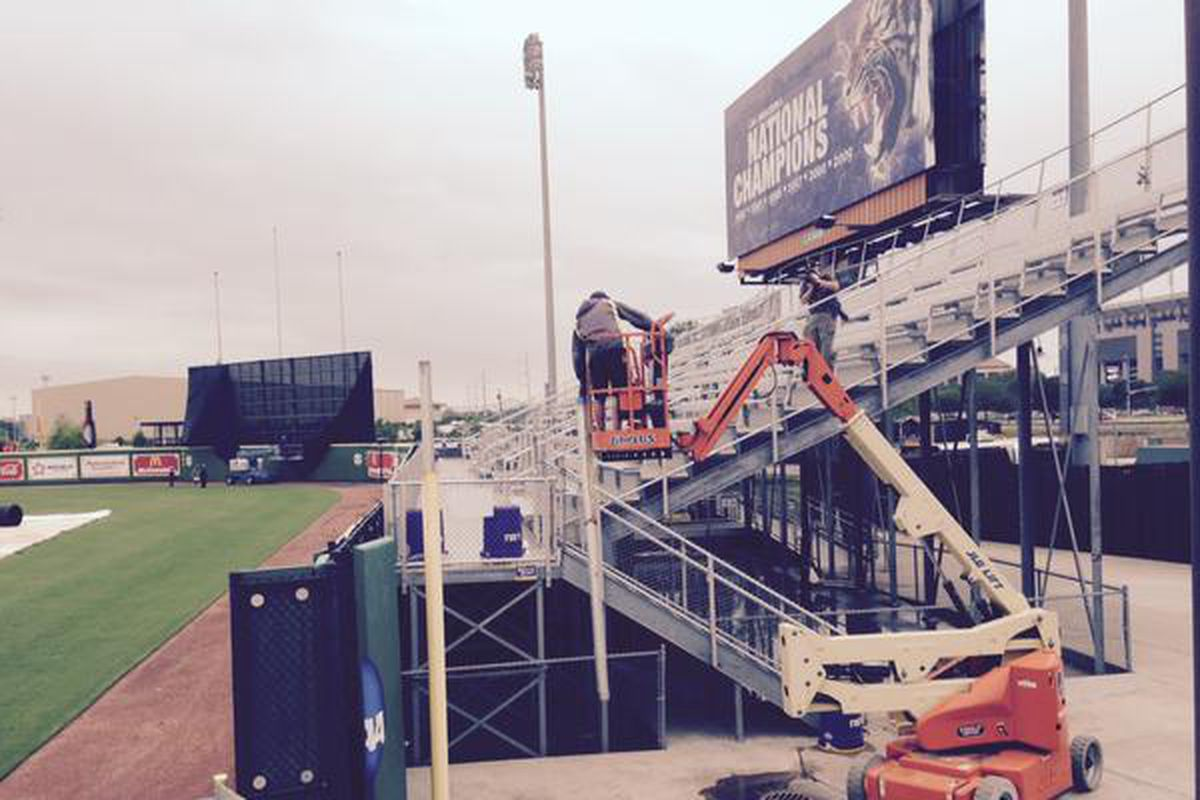 Temp Foul Poles being installed