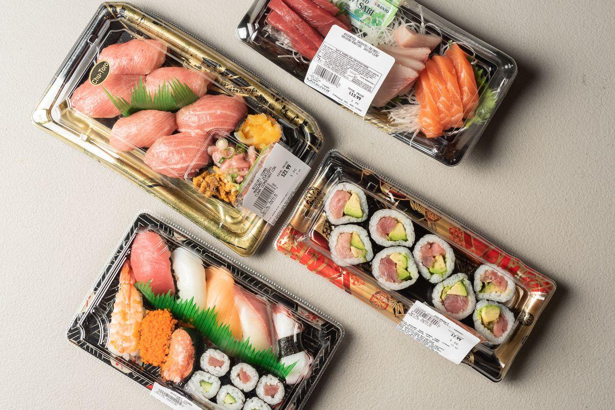 Sushi rolls, nigiri, and more in plastic trays at Mitsuwa Marketplace.