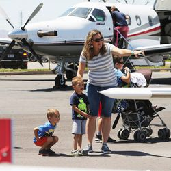 Julie Madsen points out different planes to her children Kate, Cooper, Brock, Max and Allie during the Skypark Aviation Festival and Expo at Skypark Airport in Woods Cross on Friday, June 2, 2017. The expo is Utah's largest annual aviation event.