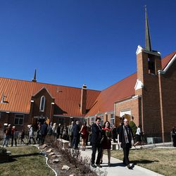 People leave Wasatch Presbyterian Church in Salt Lake City, Monday, March 9, 2015 following the funeral service for Deedee Corradini.