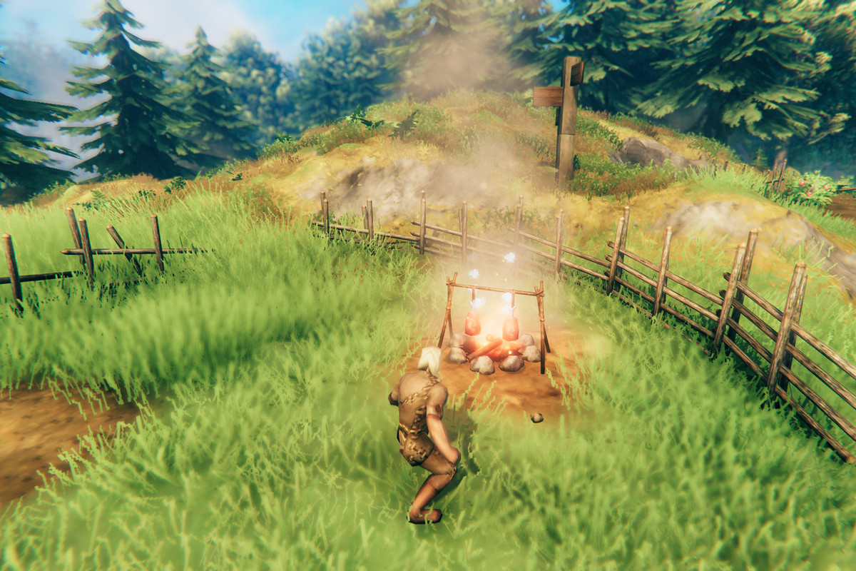A viking stands next to an open flame in Valheim