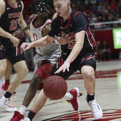 Utah Utes guard Rylan Jones (15) and Stanford Cardinal guard Daejon Davis (1) compete for the ball in Salt Lake City, Thursday, Feb. 6, 2020.