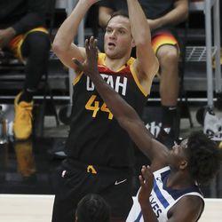 Utah Jazz forward Bojan Bogdanovic (44) shoots over Minnesota Timberwolves guard Anthony Edwards (1) in Salt Lake City on Saturday, Dec. 26, 2020.