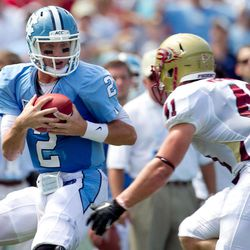 North Carolina quarterback Bryn Renner (2) catches a pass from wide receiver Erik Highsmith (88) in the second quarter against Elon in an NCAA college football game, Saturday Sept. 1, 2012, at Kenan Stadium in Chapel Hill, N.C.