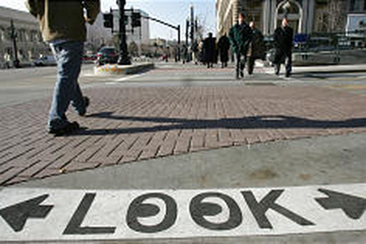 Painted sign served as a reminder to downtown pedestrians last winter to look both ways.