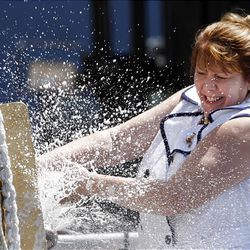 Debra Ann Dunham smashes a champagne bottle during the christening ceremony of the USS Jason Dunham, an Arleigh Burke-class guided missile destroyer, Saturday, Aug. 1, 2009, at Bath Iron Works in Bath, Maine. The ship is named after her son, the late Marine Cpl. Jason L. Dunham, of Scio, N.Y.  Dunham, 22, of Scio, N.Y., mortally wounded as he saved his comrades that day, will be honored Saturday at the christening of the Navy's newest destroyer, the USS Jason Dunham. The young corporal who threw his Kevlar helmet and his body onto the grenade became the first Marine since the Vietnam War to receive the Medal of Honor, the nation's highest military honor. (AP Photo/Robert F. Bukaty)