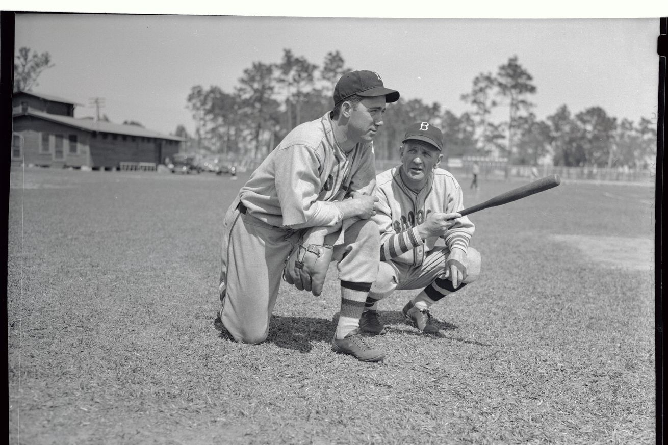 Van Lingle Mungo and Casey Stengel Stooping on Baseball Field