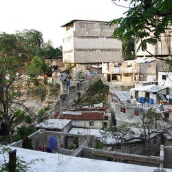 When Berthony Theodor first moved to Port Au Prince he lived in a neighborhood like this one. Today he lives in a middle class section of the city.