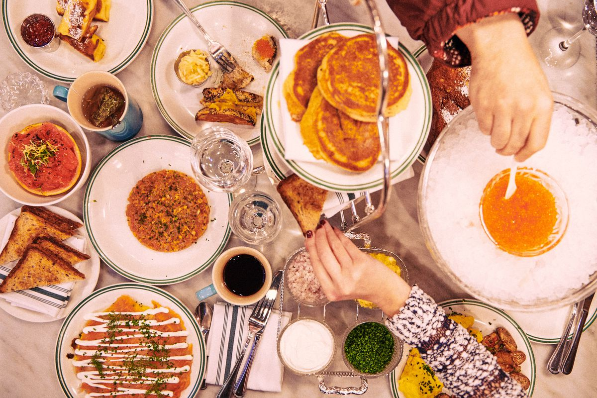 Brunch items at Sadelle's, including pancakes, caviar, and grilled cheese