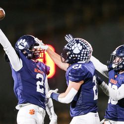 Brighton players celebrate as Tanner Church (2) catches the ball for an interception against Timpview during a high school 5A football quarterfinal at Brighton High School in Cottonwood Heights on Friday, Nov. 6, 2020.
