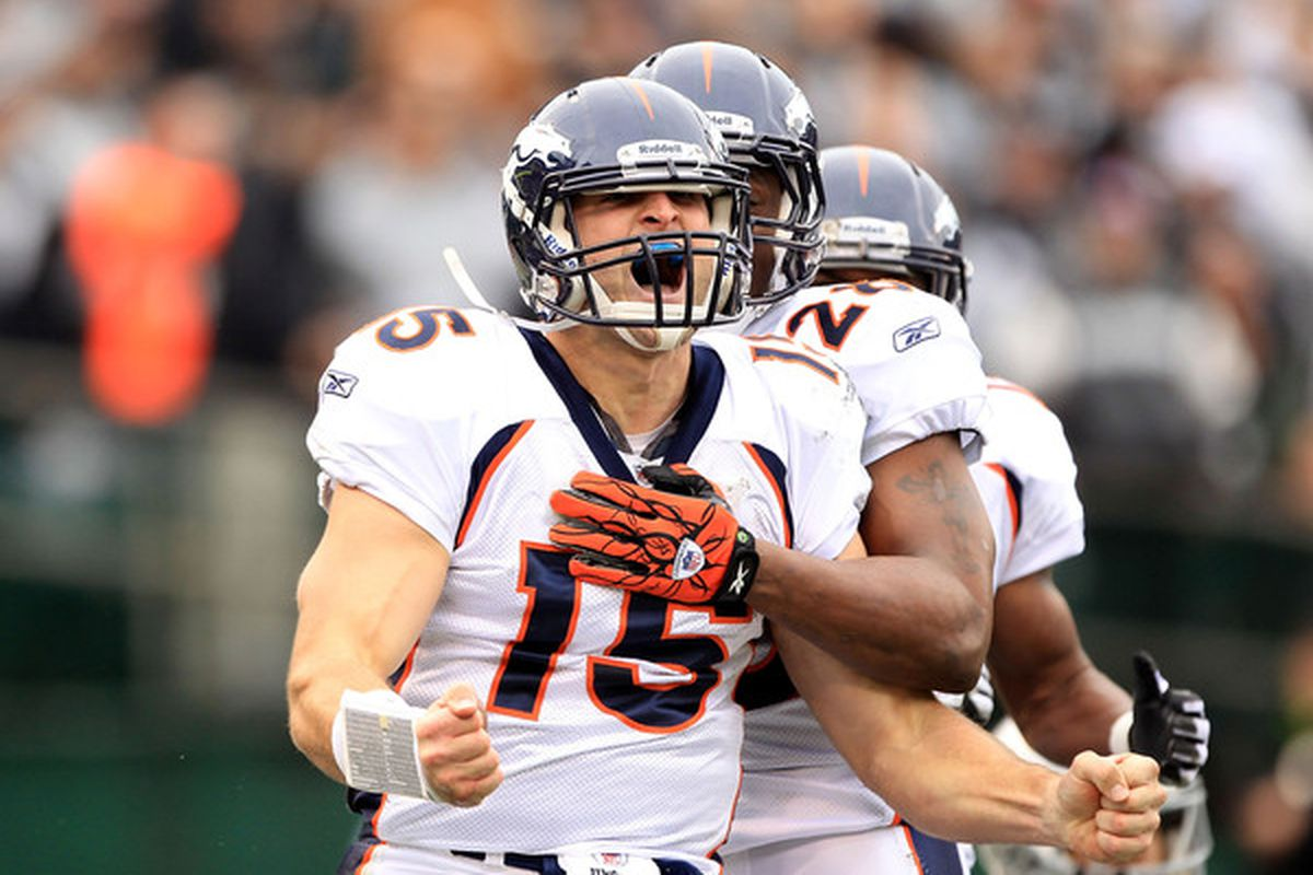 OAKLAND CA - DECEMBER 19:  Tim Tebow #15 of the Denver Broncos celebrates after he ran in for a touchdown against the Oakland Raiders at Oakland-Alameda County Coliseum on December 19 2010 in Oakland California.  (Photo by Ezra Shaw/Getty Images)