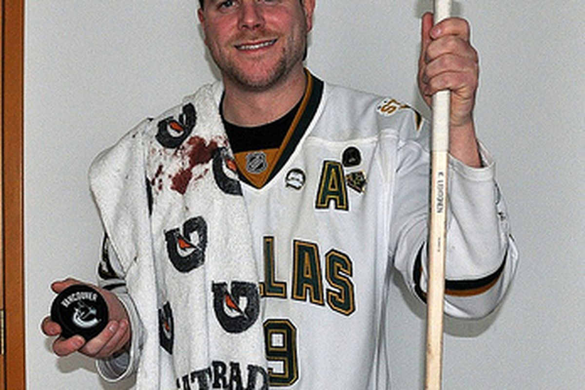 Brendan Pound of Seattle holds the puck, stick and bloody towel he got from Friday's Dallas Stars game against the Vancouver Canucks after being struck in the a face during warmup.
