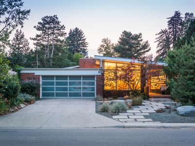 Midcentury modern home with retro orange kitchen asks $660K