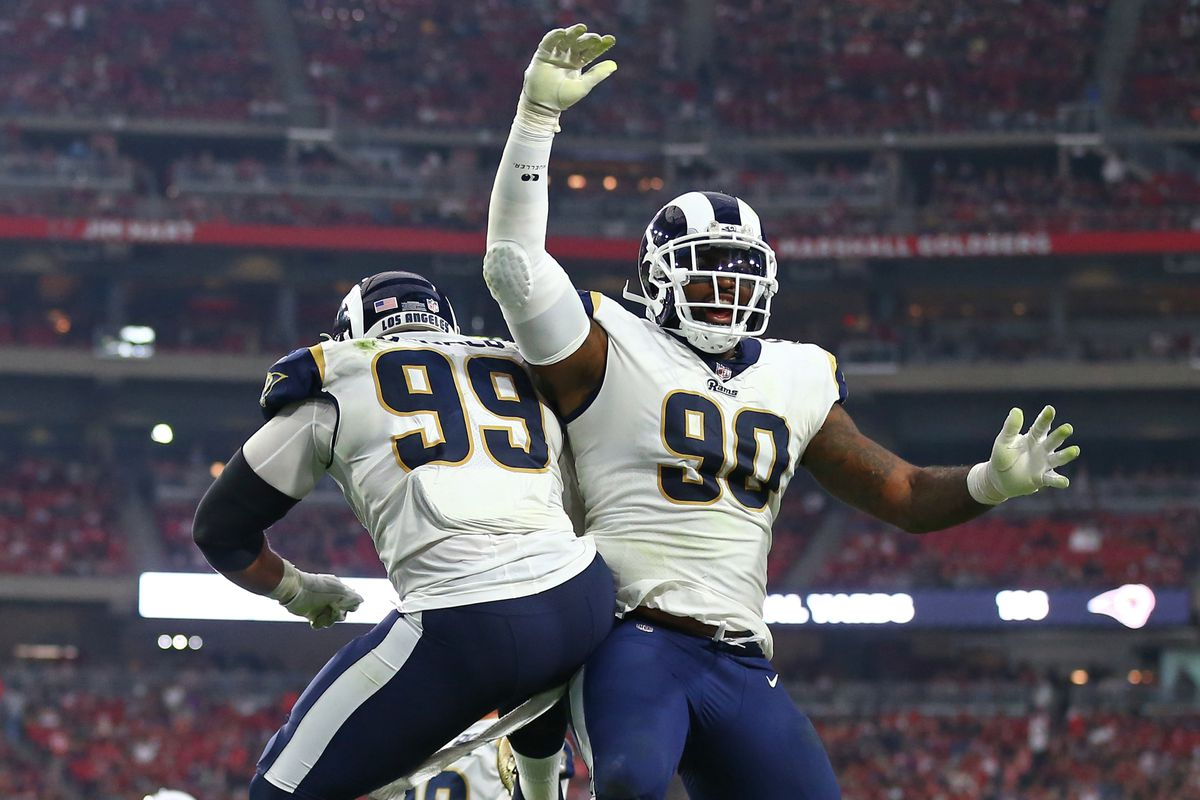 Los Angeles Rams defensive linemen Michael Brockers and Aaron Donald celebrate a play against the Arizona Cardinals in Week 13, December 3, 2017.