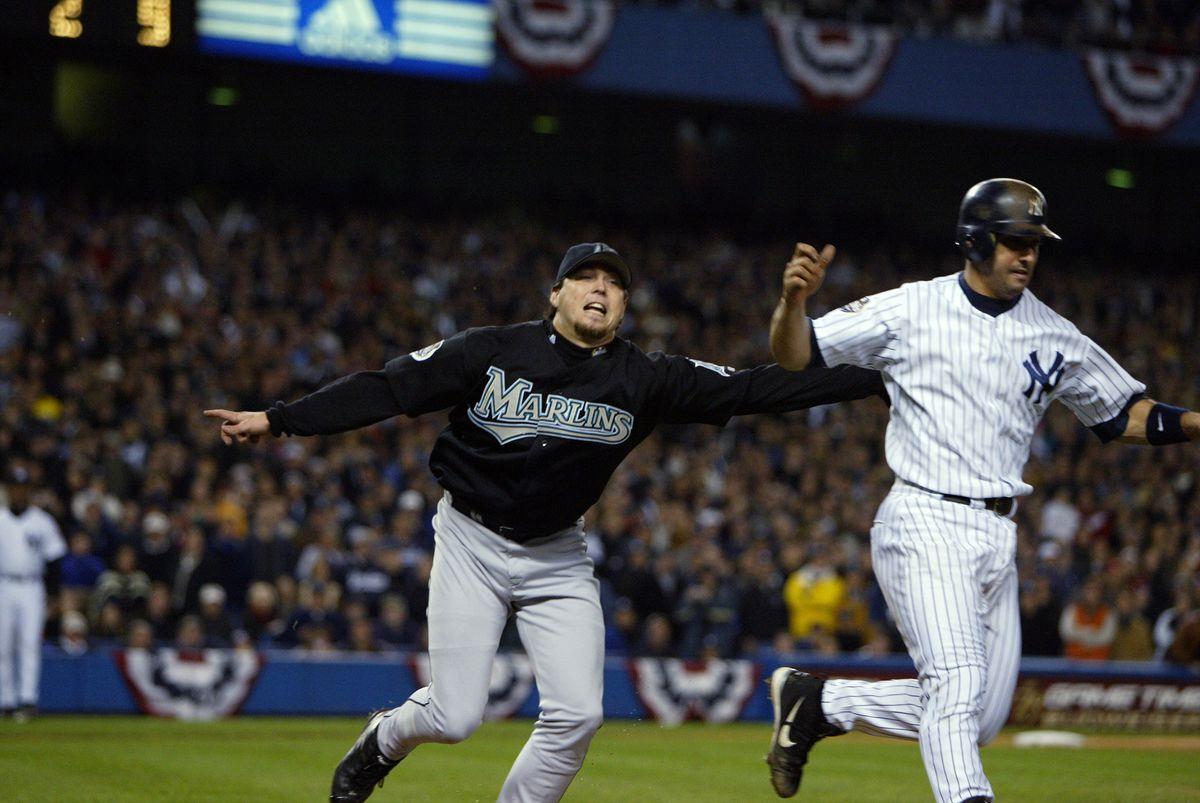 Florida Marlins' Josh Beckett tags New York Yankees' catcher