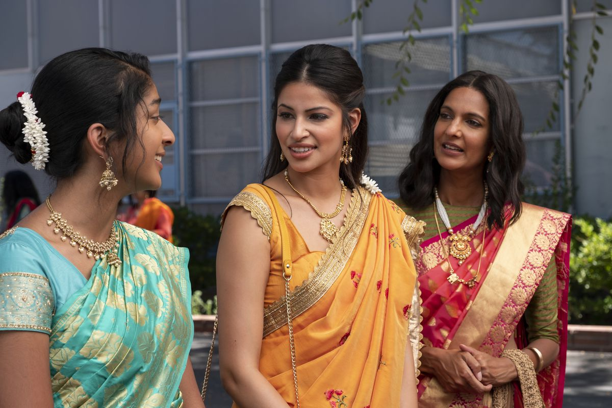 devi, her cousin, and her mom in saris