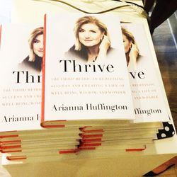 Huffington's best-selling book, on sale at the studio for $28 a pop.