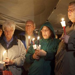 The parents of Susan Powell, Chuck Cox, far right, Judy Cox second from right, and grandparents, John Cox, second from left, and Anne Cox take part in a candlelight vigil for their daughter at the Church of Jesus Christ of Latter-day Saints in Puyallup, Wash., Sunday, Dec. 20, 2009. Susan Powell has been missing since Dec. 7.