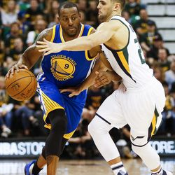Golden State Warriors forward Andre Iguodala (9) attempts to drive past Utah Jazz guard Raul Neto (25) during Game 4 of the Western Conference Semifinal at Vivint Smart Home Arena in Salt Lake City on Monday, May 8, 2017.