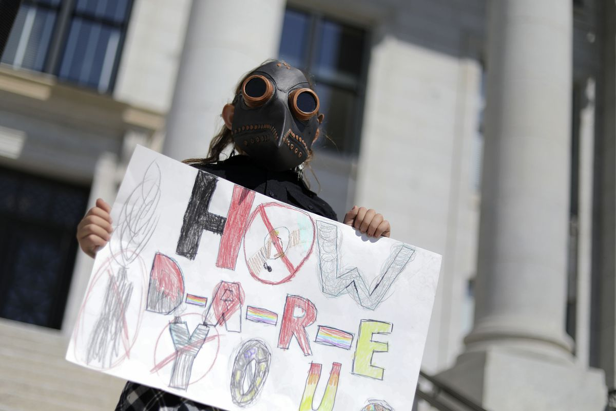 Zemirah Grossman, 9, of Salt Lake City, attends a Global Climate Strike at the Capitol in Salt Lake City.