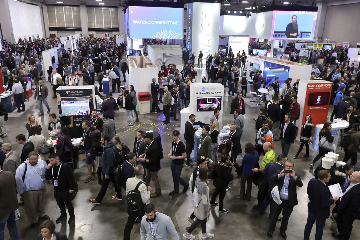 FILES - Crowds move through the Silicon Slopes Tech Summit at the Salt Palace Convention Center in Salt Lake City on Thursday, Jan. 31, 2019.