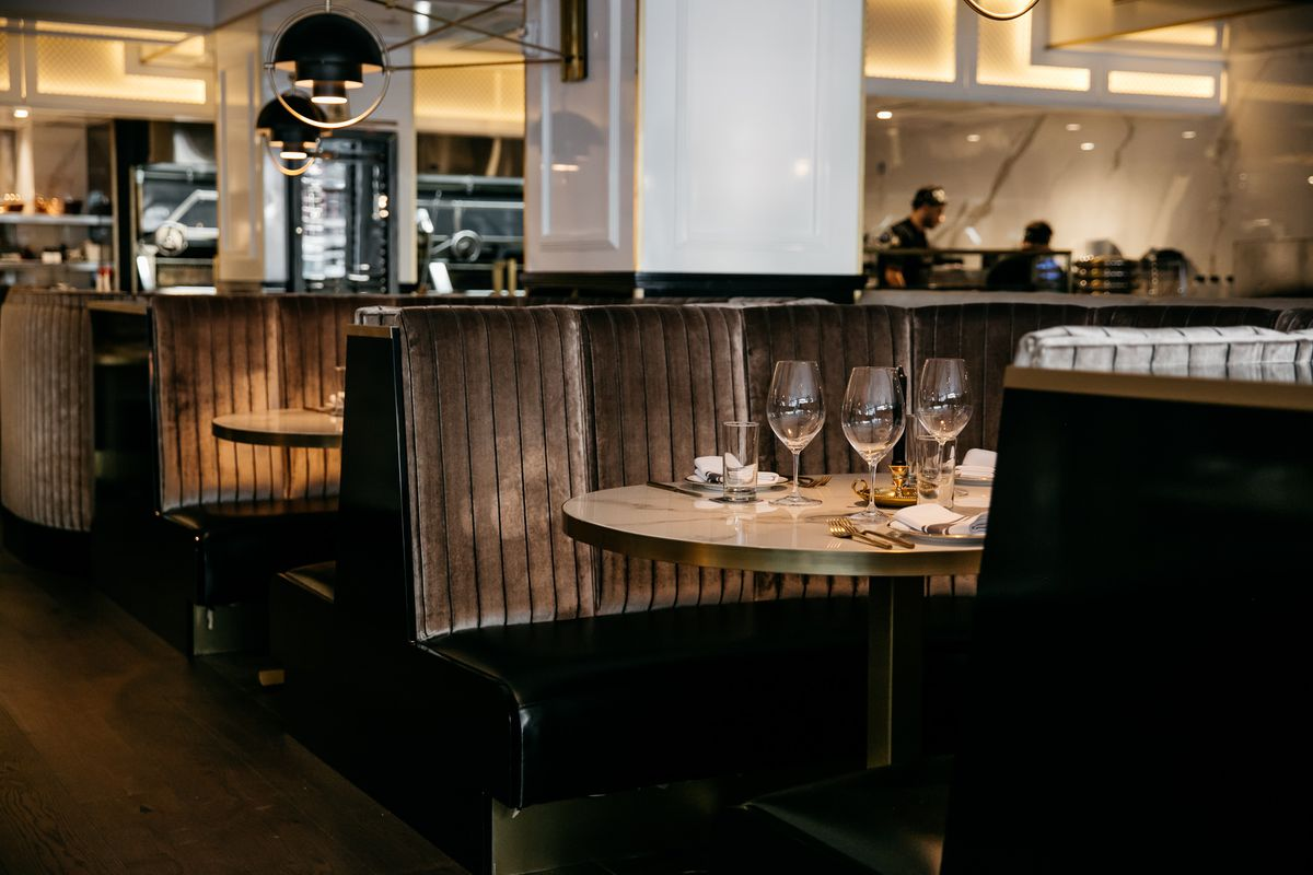 Gray circular booths inside Prime and Proper.